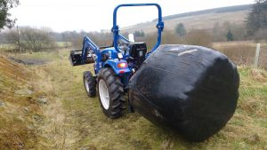 haylage bale on tractor