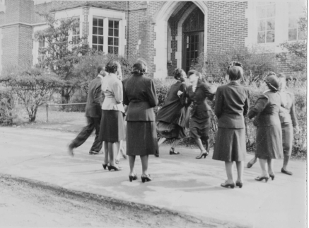 Students dance as part of a class on rural religious education, circa 1945
