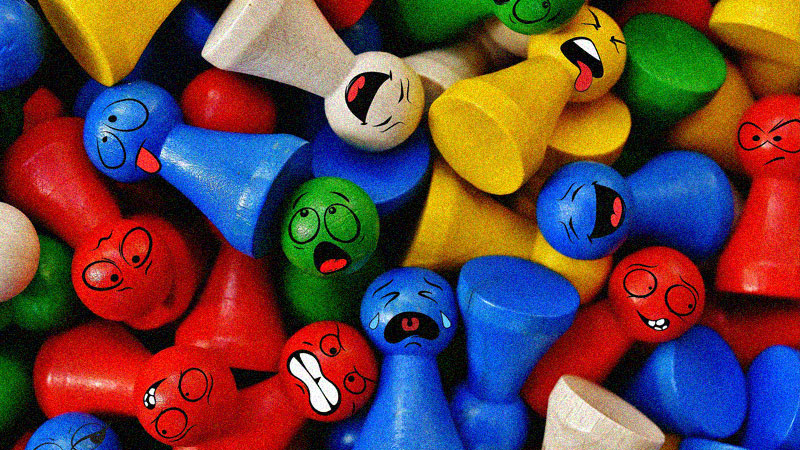 Colored wood figurines with various facial expressions