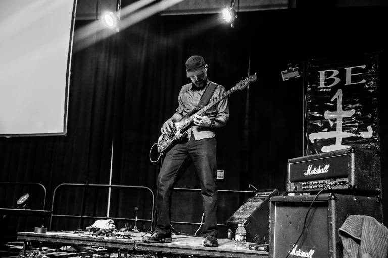 Dean Dunakin playing bass, photo by Emily Gualdoni Photography