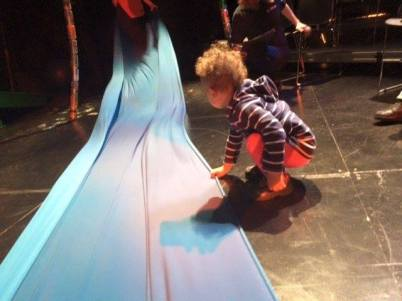 Lilly helps the run crew straighten the silk. Magic Rainforest at Lewis Center for the Arts, Princeton University.