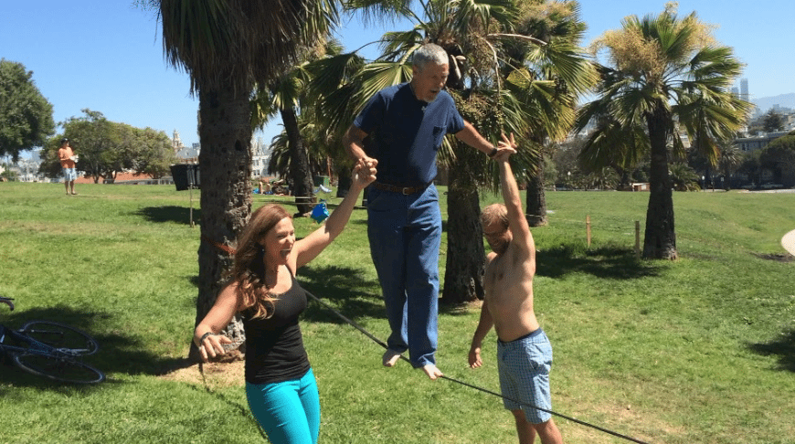 Hanging out at Dolores Park waking on a tight rope!