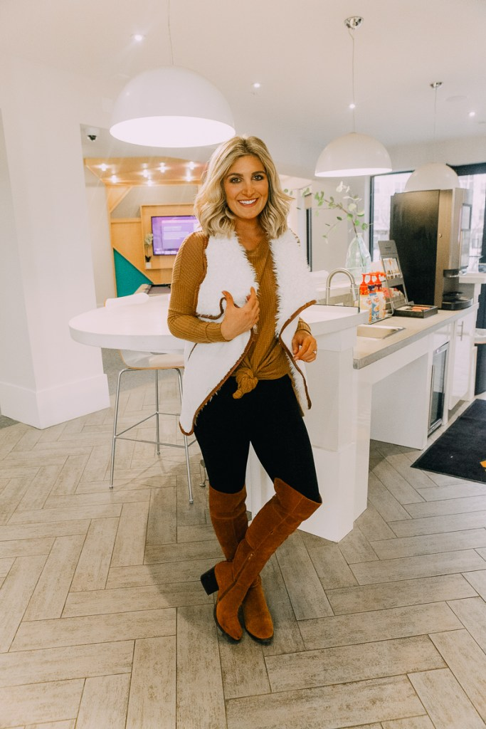 How To Style Leggings For Work featured by top US fashion blogger Audrey Madison Stowe; Image of a woman wearing a Priceless sweater, Nordstrom high waist leggings and OTK boots.