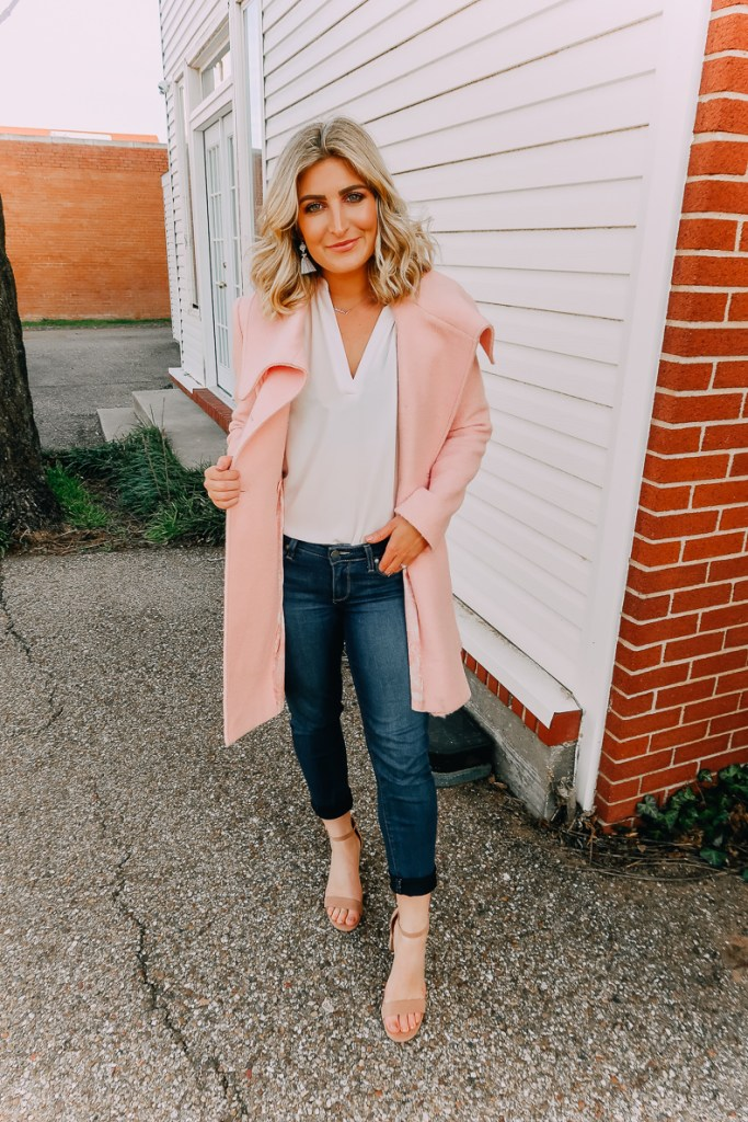 Ways To Wear a White Blouse featured by top US fashion blogger Audrey Madison Stowe; Image of woman wearing white blouse, pink coat and nude heels.