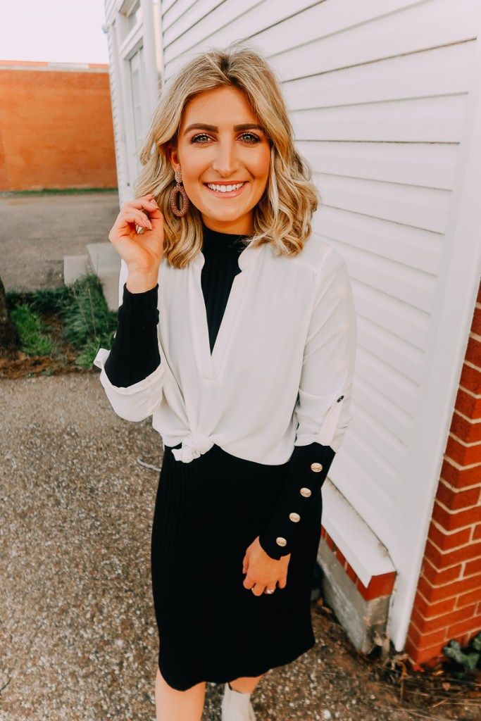 Ways To Wear a White Blouse featured by top US fashion blogger Audrey Madison Stowe; Image of woman wearing white blouse and black midi sweater dress.