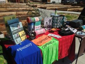 Warrior Power One set up a booth for Audubon Park's Parking Day. All of the clothing they sell is manufactured in the U.S.A., including yoga pants made from recycled plastic bottles.