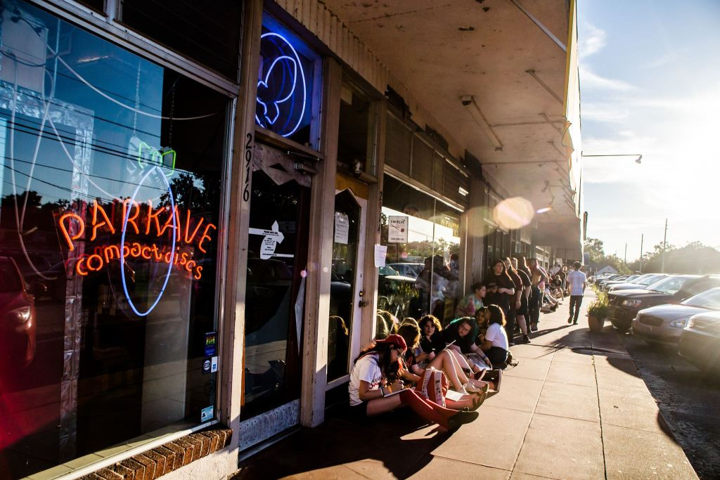 People lined up outside of Park Ave CDs store front