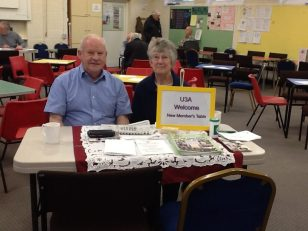 Judy and Brian are at the Welcome Desk all ready to greet and help newcomers.