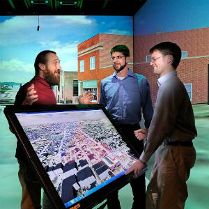 Peter Sforza (center) previously worked on a 3-D Blacksburg modeling project with Nicholas Polys, director of visual computing with the Virginia Tech Research Computing Group (left), and Thomas Dickerson, a former Virginia Tech research associate.