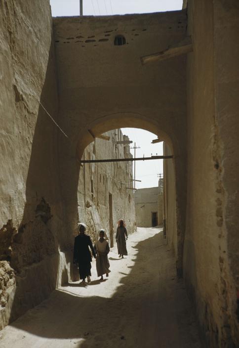 old kuwait neighborhood street archway bridge