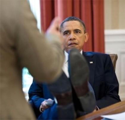 ObamaFeetDeskOvalListeningSomber