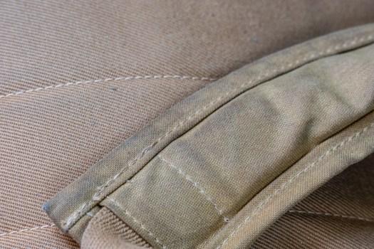 Tin cloth backpack shoulder straps darkening.