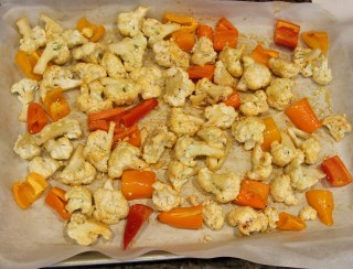 cauliflower and peppers ready to roast