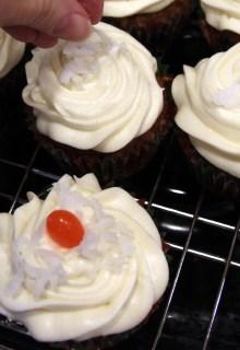 garnishing carrot cupcakes