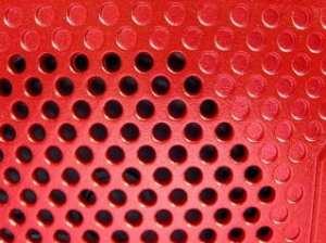 Partial image of a radio speaker.