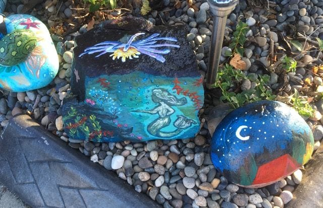 Turtle, mermaid and night sky painted on rocks