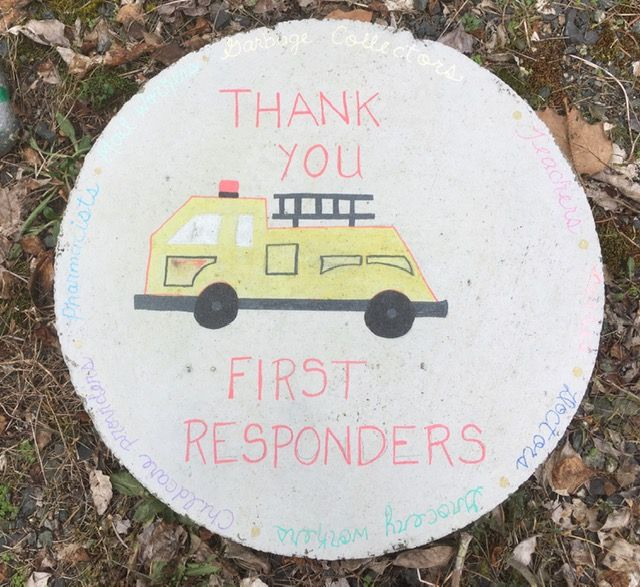 An image of a fire truck with a note thanking first responders.