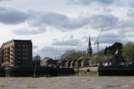 The spire of St Paul's Shadwell can be seen over the Shadwell Basin. The current building dates back to 1820.