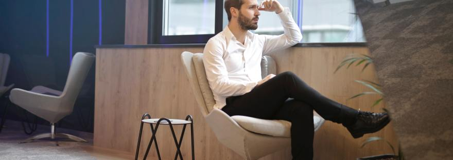 man thinking about career coach guidance
