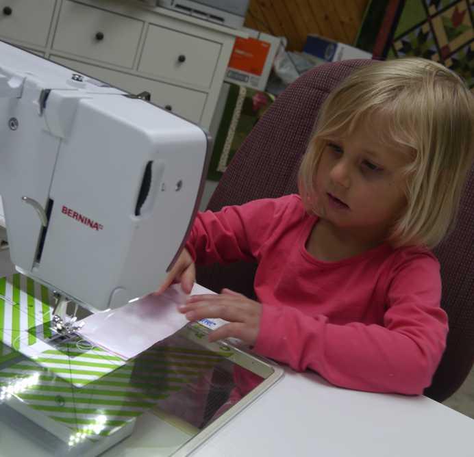 14.  KC sewing.jpg
