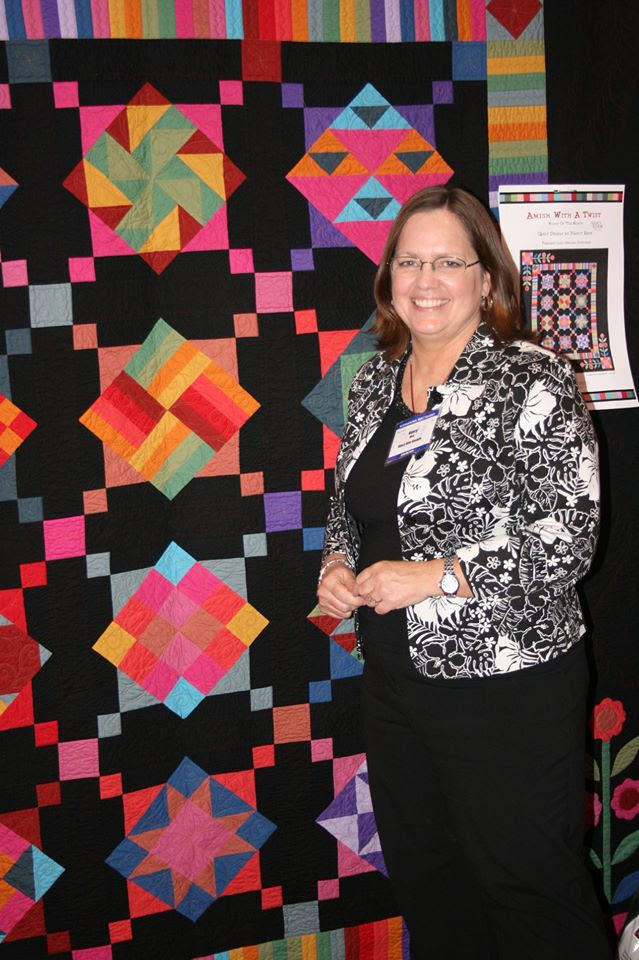 Here I am with Amish With a Twist at Quilt Market.