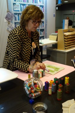 Pat giving a demo at Aurifil's Spring Market Booth, 2017