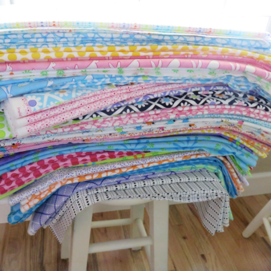 A stack of Frolic fabrics -- @meandmysisterdesigns