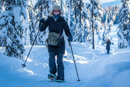 young woman snowshoeing