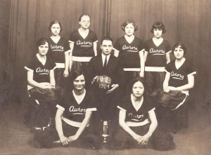 The Aurora High School's 1924 Victorious Girls' Basketball Team. 1st row seated l-r: Nellie (Nella) Isham & Mabel Jackson, second row, Agnes Dreyer, Coach & Principal J.O. Fox, & Alice Dreyer, third row, Lois Riley, Leila Riley, Florence Dreese. The Dreyer twins in the second row are Donna Mattmuller and Jane Burns' Mother and Aunt.