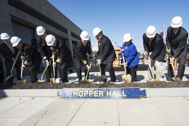 ANNAPOLIS, Md. (Oct. 21, 2016) The official party of the Hopper Hall ground breaking ceremony at the United States Naval Academy (USNA) dig out a scoop of dirt. Hopper Hall, which will house USNA's Center for Cyber Studies, is the namesake of Rear Adm. Grace Hopper who is often referred to as 'The Mother of Computing'. (U.S. Navy photo by Petty Officer 3rd Class Brianna Jones/Released)
