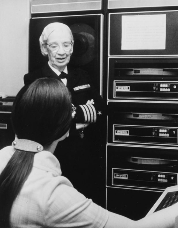 Capt. Grace Hopper, then head of the Navy Programming Language Section of the Office of the Chief of Naval Operations, discusses a phase of her work with a staff member in August 1976. (U.S. Navy photo by PH2 David C. MacLean/Released)