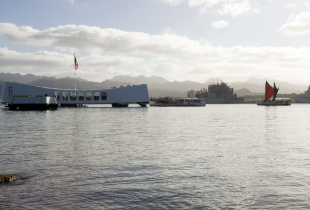 PEARL HARBOR (Feb. 10, 2018) The traditional Polynesian double-hulled voyaging canoe, Hokule'a, renders honors as it passes by the USS Arizona Memorial during its first-ever visit to the waters of Pearl Harbor. (U.S. Navy photo by Mass Communication Specialist 1st Class Jeff Troutman/Released)