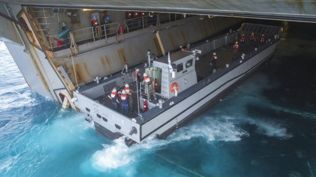 GULF OF THAILAND (Feb. 18, 2018) A Republic of Korea Navy landing craft, mechanized enters the well deck of the amphibious assault ship USS Bonhomme Richard (LHD 6) as part of a cross-decking evolution during Exercise Cobra Gold 2018. (U.S. Navy photo by Mass Communication Specialist 2nd Class Jeanette Mullinax/Released)