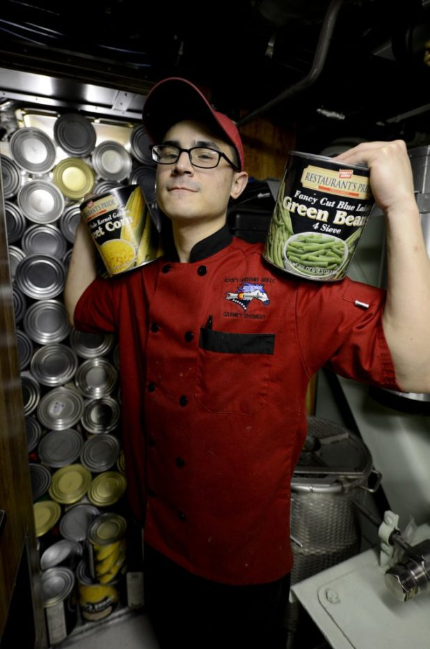 ATLANTIC OCEAN (Jan. 10, 2018) Culinary Specialist (Submarines) Seaman Carlos Sifontes poses for a photo while unloading food from the dry provisions store room aboard Pre-Commissioning Unit (PCU) Colorado (SSN 788). U.S. Navy photo by Mass Communication Specialist 1st Class Jeffrey M. Richardson/Released)