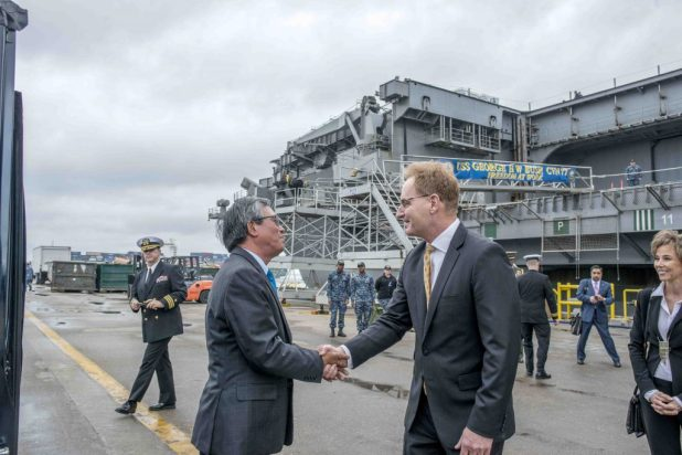 NORFOLK (Feb. 21, 2018) Ambassador of the Socialist Republic of Vietnam to the United States Pham Quang Vinh, left, shakes hands with Undersecretary of the Navy Thomas Modly during a tour of the aircraft carrier USS George H.W. Bush (CVN 77). Vinh visited the ship to promote continued interoperability and a strong relationship between the Socialist Republic of Vietnam and the U.S. The ship was in port in Norfolk, Virginia, conducting routine maintenance in preparation for the Board of Inspection and Survey (INSURV). (U.S. Navy photo by Mass Communication Specialist 1st Class Sean Hurt/Released)
