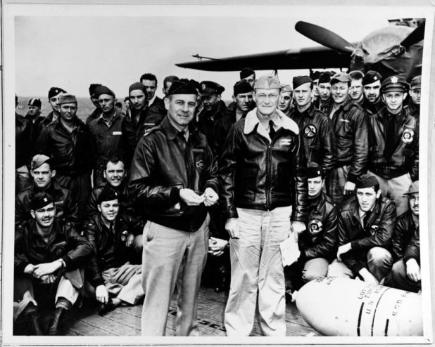 Lt. Col. James H. Doolittle (left front), leader of Doolittle Raid's attacking force, and Capt. Marc A. Mitscher, commanding officer of USS Hornet (CV 8), pose with a 500-pound bomb and USAAF aircrew members during ceremonies on Hornet's flight deck, while the raid task force was en route to the launching point, April 18, 1942. (U.S. Navy photo/Released)