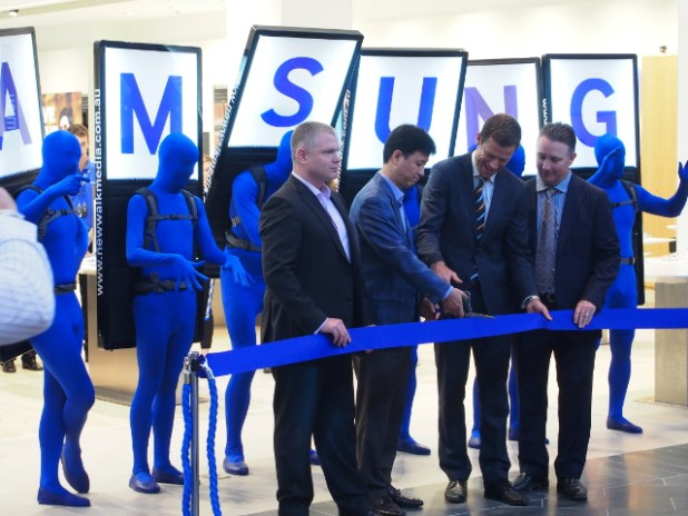 Mr S R Yoon (managing director, Samsung Australia) cutting the ribbon, officially opening the new store.