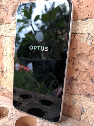 Optus Branding with the fingerprint scanner just above that directly in the middle rear of the device