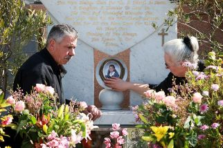 George and Christina Halvagis at the grave of their daughter Mersina Halvagis.