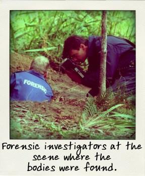 Forensic investigators at the scene where the bodies were found.-pola