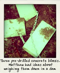 Three pre-drilled concrete blocks with cord passed through them that Matthew originally planned to use them to weigh the bodies down.-pola