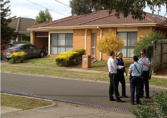 Police outside the house in Marcia Court, Glen Waverley.