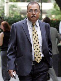 Vijay Singh, father of slain siblings Neelma, Kunal and Sidhi, arrives at court.