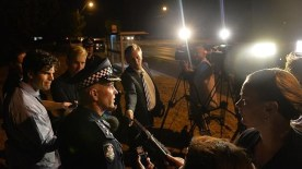 Commander Doug Fryer talks to the media at the scene last night.