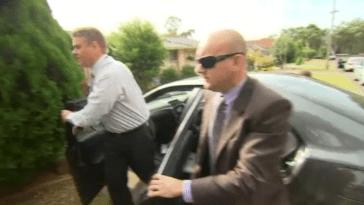 Detectives have arrived at Roger Rogerson's home