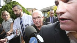 Detectives lead Roger Rogerson from his Padstow Heights home