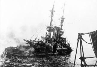 HMS 'Irresistible' abandoned 18th March 1915 -Photo published in The War Illustrated, 1 May 1915.