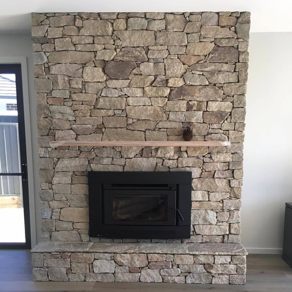 stone fireplace clad with Franklin Walling granite stone