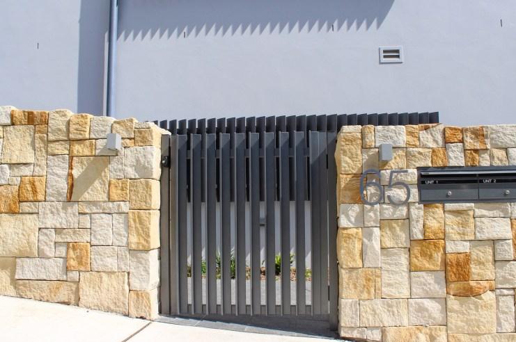 Australian banded sandstone walling seen in a residential house garden stone fence