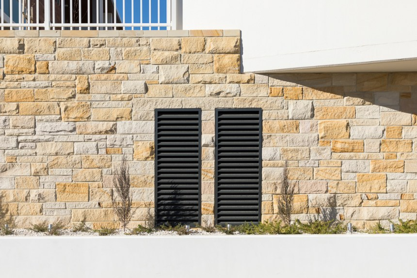 Part of a stone house using australian sandstone wall cladding, stones are rectangular shape with split face